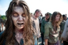 """In this image released by AMC, zombies appear in a scene from the second season of the AMC original series, """"The Walking Dead,"""" in Senoia, Ga.  (AP Photo/AMC, Gene Page)"""