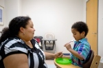 Marlaina Dreher, left, looks on to see if her 5-year-old son Brandon will feed himself during a session at the Marcus Autism Center in Atlanta on Wednesday, Sept. 18, 2013. (AP / David Goldman)