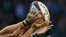 Players battle for a rugby ball in this Nov. 9, 2013 file photo. (AP / Sang Tan)