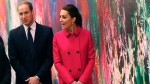 In this Dec. 9, 2014 file photo, Britain's Prince William, Duke of Cambridge, left, and Kate, Duchess of Cambridge, walk in front of a mural by Jose Parla as the royal couple takes a tour of the lobby of new One World Trade Center following a visit to the nearby National September 11 Memorial and Museum, in New York. (AP / Shannon Stapleton, Pool, File)