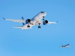 Bombardier's CS300, left, is followed by a chase plane, right, as it takes off on its maiden test flight in Mirabel, Que., on Friday, February 27, 2015. (THE CANADIAN PRESS/Ryan Remiorz)