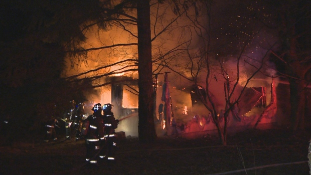 Crews battle a fully involved blaze at a double-wide trailer in a rural area just outside of Comox, B.C. at around 4 a.m. Monday, Feb. 8, 2016. A 94-year-old man was found dead inside of the building. (CTV Vancouver Island)