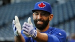 Toronto Blue Jays right-fielder Jose Bautista warms up before Game 1 of baseball's American League Championship Series against the Kansas City Royals on Friday, Oct. 16, 2015, in Kansas City, Mo. (THE CANADIAN PRESS/AP-Paul Sancya)