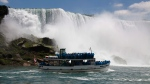 In this Friday, June 11, 2010 photo, tourists ride the Maid of the Mist tour boat at the base of the American Falls in Niagara Falls, N.Y. (AP / David Duprey)