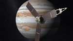 This 2010 artist's rendering depicts NASA's Juno spacecraft with Jupiter in the background. (AP Photo/NASA/JPL, File)