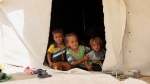 In this picture taken on Saturday, June 25, 2016, internally displaced children from Fallujah, who fled their homes during fighting between Iraqi security forces and the Islamic State group, rest at a camp at Amariyat Fallujah, Iraq. (Khalid Mohammed/AP Photo)