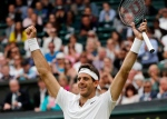Juan Martin del Potro of Argentina celebrates after beating Stan Wawrinka of Switzerland in their men's singles match on day five of the Wimbledon Tennis Championships in London, Friday, July 1, 2016. (AP / Ben Curtis)