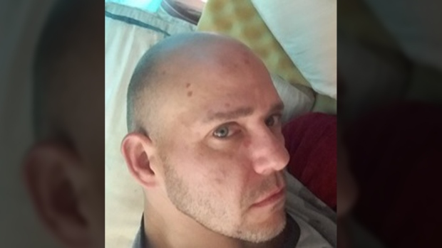 The picture of the blue-eyed suspect with a shaved head appears to be a selfie and Nanaimo RCMP have posted the man's photo on their website. July 21, 2016. (Nanaimo Crimestoppers)
