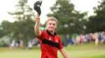 Jared du Toit, of Canada, acknowledges the crowd on the 18th hole during the final round at the Canadian open golf tournament at Glen Abbey in Oakville, Ontario, on Sunday, July 24, 2016. THE CANADIAN PRESS/Nathan Denette