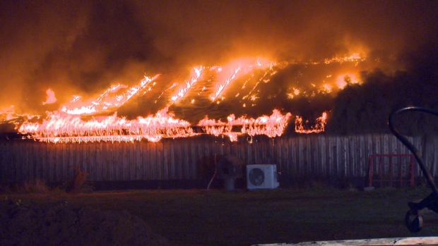 Crews from Courtenay and Oyster River battled a barn fire that broke out late at night Sunday, July 24, 2016. (CTV Vancouver Island)