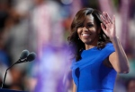 First Lady Michelle Obama takes the stage during the first day of the Democratic National Convention in Philadelphia, Monday, July 25, 2016. (AP Photo/Paul Sancya)