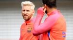Barcelona's star striker Lionel Messi, left, at St George's Park, Burton, England, on July 26, 2016. (Mike Egerton/PA via AP)