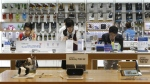 Visitors try out Samsung Electronics Galaxy smartphones at the company's showroom in Seoul, South Korea on Thursday, July 28, 2016. (AP / Ahn Young-joon)