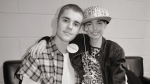 Justin Bieber is shown with Kaylee Drew, 9, a cancer patient in Boston, Mass. (Facebook / Pam Drew)