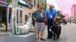 Two men are seen using the Autour app on the streets of Montreal.