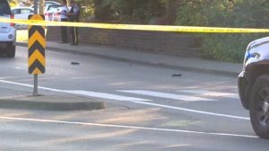 Shoes are seen in the middle of the road after a 24-year-old woman was struck by a vehicle in a Courtenay crosswalk Tues., Aug. 23, 2016. (CTV Vancouver Island)