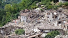 Rescuers search through debris of collapsed houses following an earthquake in Pescara del Tronto, Italy, Wednesday, Aug. 24, 2016. (Sandro Perozzi/AP)