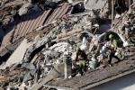 Rescuers make their way through destroyed houses following an earthquake in Pescara Del Tronto, central Italy, Thursday, Aug. 25, 2016. (AP Photo/Gregorio Borgia)