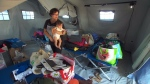Life in limbo for survivors in tents