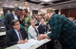 A demonstrator confronts Montreal Mayor Denis Coderre as they disrupt the National Energy Board public hearing into the proposed $15.7-billion Energy East pipeline project proposed by TransCanada, in Montreal, Monday, Aug. 29, 2016. (Paul Chiasson / THE CANADIAN PRESS)