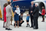 Prime Minister Justin Trudeau, centre, kneels to talk to Prince George as his father The Duke of Cambridge speaks with Governor General David Johnston, right, and The Duchess of Cambridge holds their daughter Princess Charlotte upon arrival in Victoria, B.C., on Saturday, September 24, 2016. (THE CANADIAN PRESS/Jonathan Hayward)