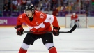Canada's Sidney Crosby waits for a face-off against Sweden during the first period of the men's gold medal ice hockey game at the 2014 Winter Olympics, Sunday, Feb. 23, 2014, in Sochi, Russia. (THE CANADIAN PRESS/ AP/Matt Slocum)