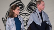 Prince William, the Duke of Cambridge, and Kate, the Duchess of Cambridge, stand together after being draped in traditional First Nation blankets during a welcoming ceremony at the Heiltsuk First Nation in the remote community of Bella Bella, B.C., on Monday, Sept, 26, 2016. (Darryl Dyck / THE CANADIAN PRESS)