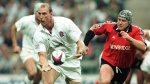 Gareth Rees, right, captain of the rugby union team about to tackle England's Lawrence Dallaglio at Twickenham, London on August 28, 1999. (Findlay Kember / AP)