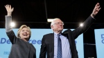 Democratic presidential candidate Hillary Clinton and Sen. Bernie Sanders, I-Vt., take the stage during a campaign stop at the University Of New Hampshire in Durham, N.H., Wednesday, Sept. 28, 2016. (Matt Rourke/AP)