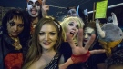 People dressed in Halloween costumes pose for a photo as they attend the Halloween celebration in a night club in Moscow, Russia, early Sunday, Nov. 1, 2015. (AP / Denis Tyrin)