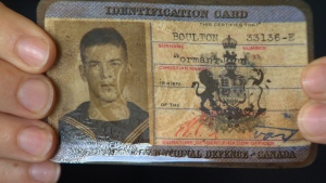 Dozens of historic naval artifacts, such as this sailor's perfectly preserved wallet and ID card, have been unearthed by crews performing remediation work in the Esquimalt Harbour. Oct. 20, 2016. (CTV Vancouver Island)