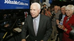 Sen. John McCain, R-Ariz., walks past supporters as he heads up to the stage to speak after being declared the winner in the Arizona Republican primary in Phoenix on Aug. 30, 2016. (AP / Ross D. Franklin)