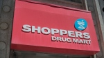 The logo for Shoppers Drug Mart is shown in downtown Toronto, on Tuesday, May 24, 2016. (THE CANADIAN PRESS/Eduardo Lima)