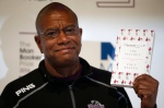 Writer Paul Beatty poses for the media with his book 'The Sellout' during a photocall for the 6 shortlisted authors for the Man Booker Prize for fiction in London, Monday, Oct. 24, 2016. (AP / Alastair Grant)