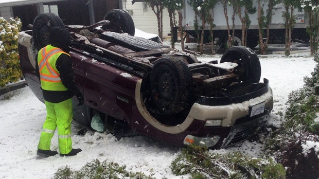 An SUV crashed into the yard of a Nanaimo home, flipping onto its roof, just off the Island Highway at Millstone Avenue and St. George Street Friday, Dec. 9, 2016. (CTV Vancouver Island)