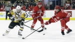 Pittsburgh Penguins' Sidney Crosby (87) tries to get a shot past Carolina Hurricanes' Ron Hainsey (65) as Hurricanes' Lee Stempniak (21) looks on during the first period of an NHL hockey game in Raleigh, N.C., Friday, Jan. 20, 2017. (AP / Gerry Broome)